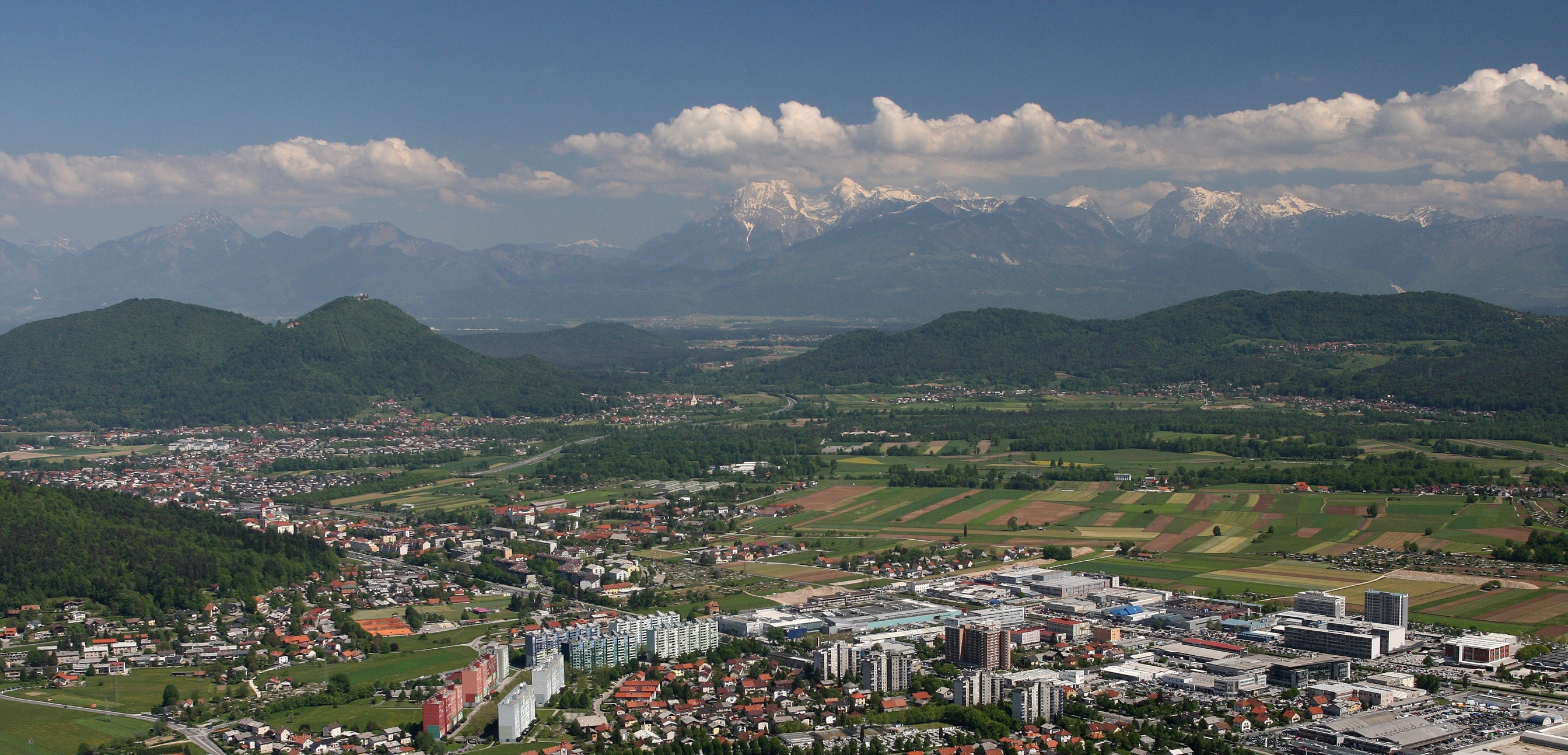 Lubljana Dravlje with snow capped Alps behind
